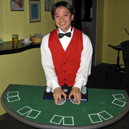 smiling live blackjack dealer