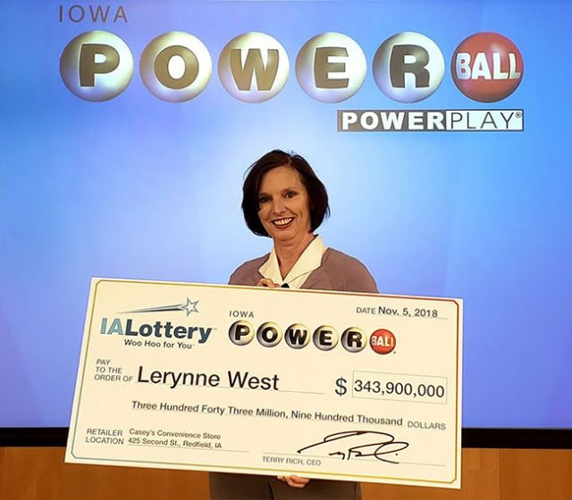 Lerynne West with winning lotto ticket